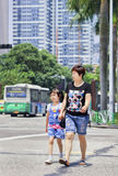 Mom with daughter on the street, Zhuhai, China. ZHUHAI-CHINA-SEPT. 7. Eight years old Li Wang Jing with mom on the street. China`s one-child policy was stock photo