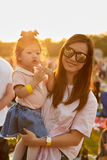 Mom and daughter in sunset Royalty Free Stock Images