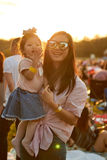 Mom and daughter in sunset Stock Photography