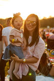 Mom and daughter in sunset Stock Images
