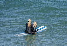 Mom and daughter surfing royalty free stock photos