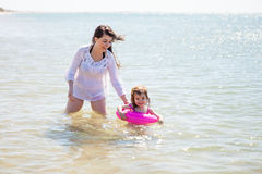 Mom and daughter swimming Stock Photo