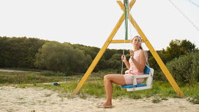 Mom and daughter on a swing stock video