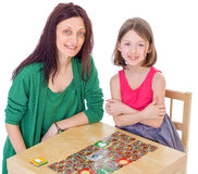 Mom and daughter at the table. Royalty Free Stock Photo