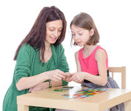 Mom and daughter at the table. Royalty Free Stock Photography