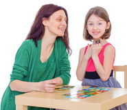 Mom and daughter at the table. Royalty Free Stock Photos