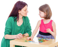 Mom and daughter at the table. Royalty Free Stock Images