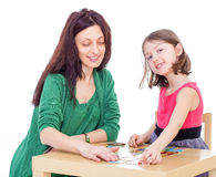 Mom and daughter at the table. royalty free stock image