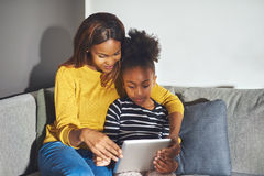 Mom and daughter with tablet royalty free stock photos