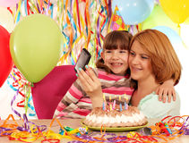 Mom and daughter take pictures at a birthday Stock Image