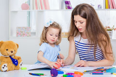 Mom and daughter together Royalty Free Stock Image