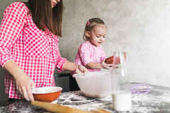Mom and daughter together in the kitchen Royalty Free Stock Photo