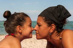 Mom and daughter touching noses Royalty Free Stock Photos