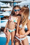 Mom and daughter on vacation. Posing on cameran Royalty Free Stock Images