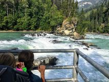 A mom and daughter viewing the salmon run in the summer stock image