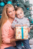Mom and daughter waiting for Christmas Royalty Free Stock Photography
