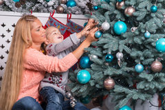 Mom and daughter waiting for Christmas Royalty Free Stock Photos
