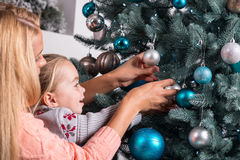 Mom and daughter waiting for Christmas Royalty Free Stock Photo