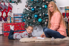 Mom and daughter waiting for Christmas stock photos