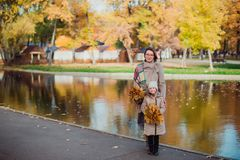 Mom and daughter and walk in the autumn Park near the lake royalty free stock photography