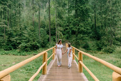 Mom and daughter walking near the lake . Royalty Free Stock Images