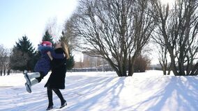 Mom and daughter walking in the winter Park stock video footage