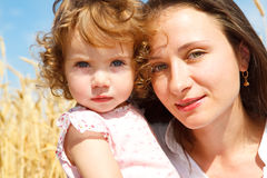 Mom and daughter in wheat Stock Photography