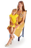 Mom and daughter in yellow stock images