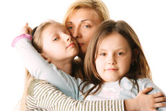 Mom with daughters. Mom with two little daughters photo over white Stock Photos