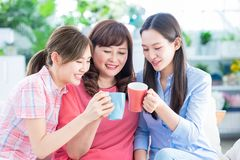 Mom and daughters drink together stock photo