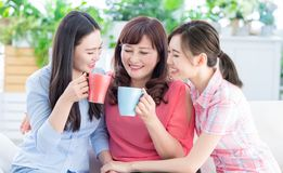Mom and daughters drink together stock photos