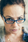 Mom disapproval. Woman looking straight with disapproval expression Stock Photography
