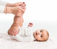 Mom is doing exercises with her baby Stock Photo