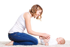 Mom doing exercises with your baby on the floor. Royalty Free Stock Photo