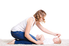 Mom doing exercises with your baby on the floor. Stock Photo