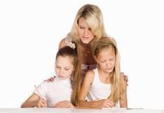 Mom draws with daughters. Cute mom draws with her little daughters Stock Photos
