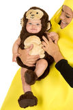 Mom dressed as banana with monkey baby close Royalty Free Stock Photo