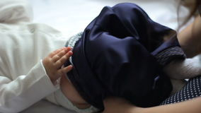 Mom dresses baby pants Close-up. stock video footage