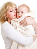 Mom embracing baby Stock Photography