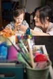 Mom Feeding Baby Royalty Free Stock Photos