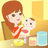 Mom feeding milk to baby Stock Photo