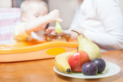 Mom feeds the baby pure. Juice. Drink Stock Image