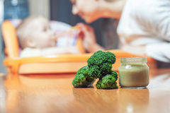 Mom feeds the baby soup. Healthy and natural baby food Royalty Free Stock Photography