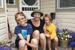 Mom fighting breast cancer with her kids outside stock images