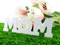 Mom and flower bouquet with fabric mothers day concept Stock Photo