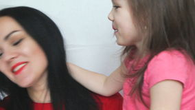 Mom and funny little daughter stock video footage