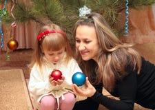 Mom and girl   christmas tree Stock Photography