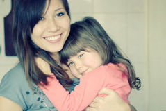Mom and girl hugging and laughing Royalty Free Stock Photos