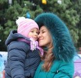 Mom and girl near a Christmas tree Stock Photography