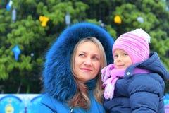 Mom and girl near a Christmas tree Royalty Free Stock Image